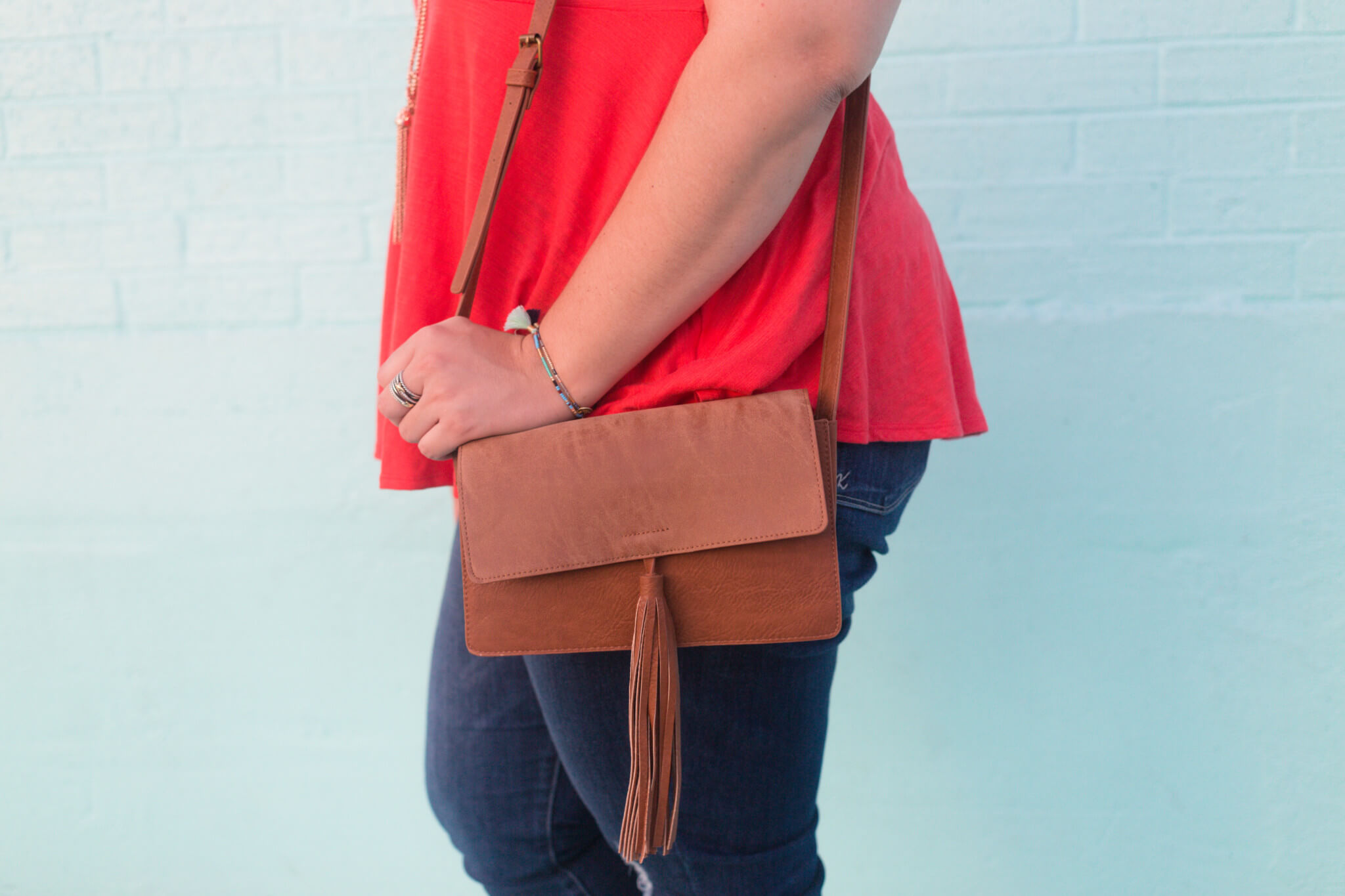 Tassels are a huge trend this fall and this bag from Nordstrom is a dream come true! | Something Gold, Something Blue a curvy fashion blog by Emily Bastedo
