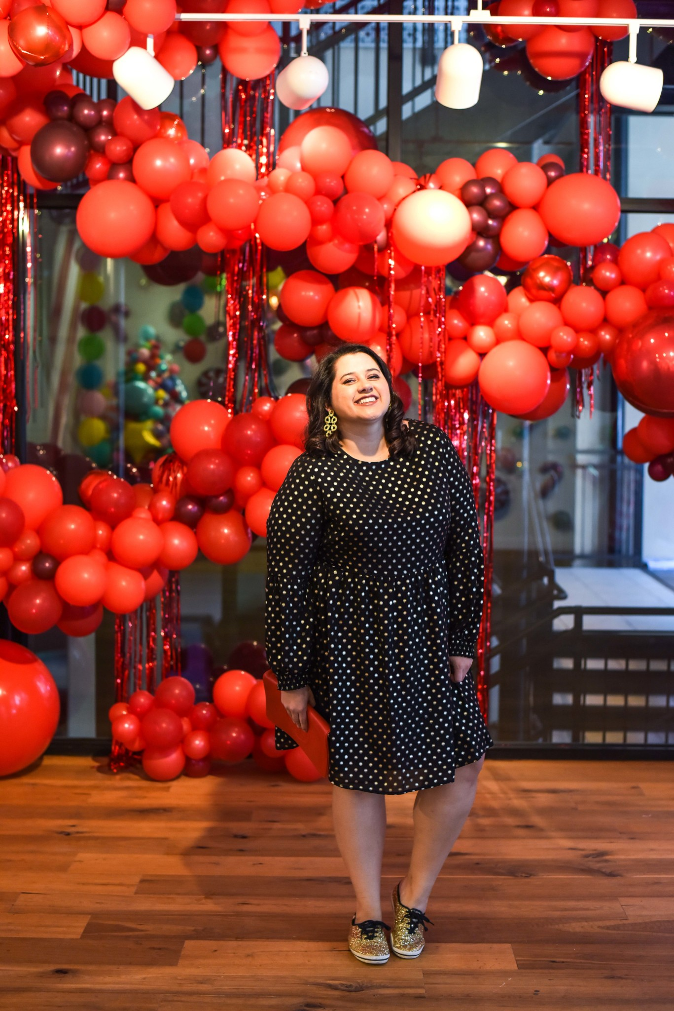 Celebrating the joys of the holidays with a little pop of red, a pair of sneakers and lots of glitter. #plussize