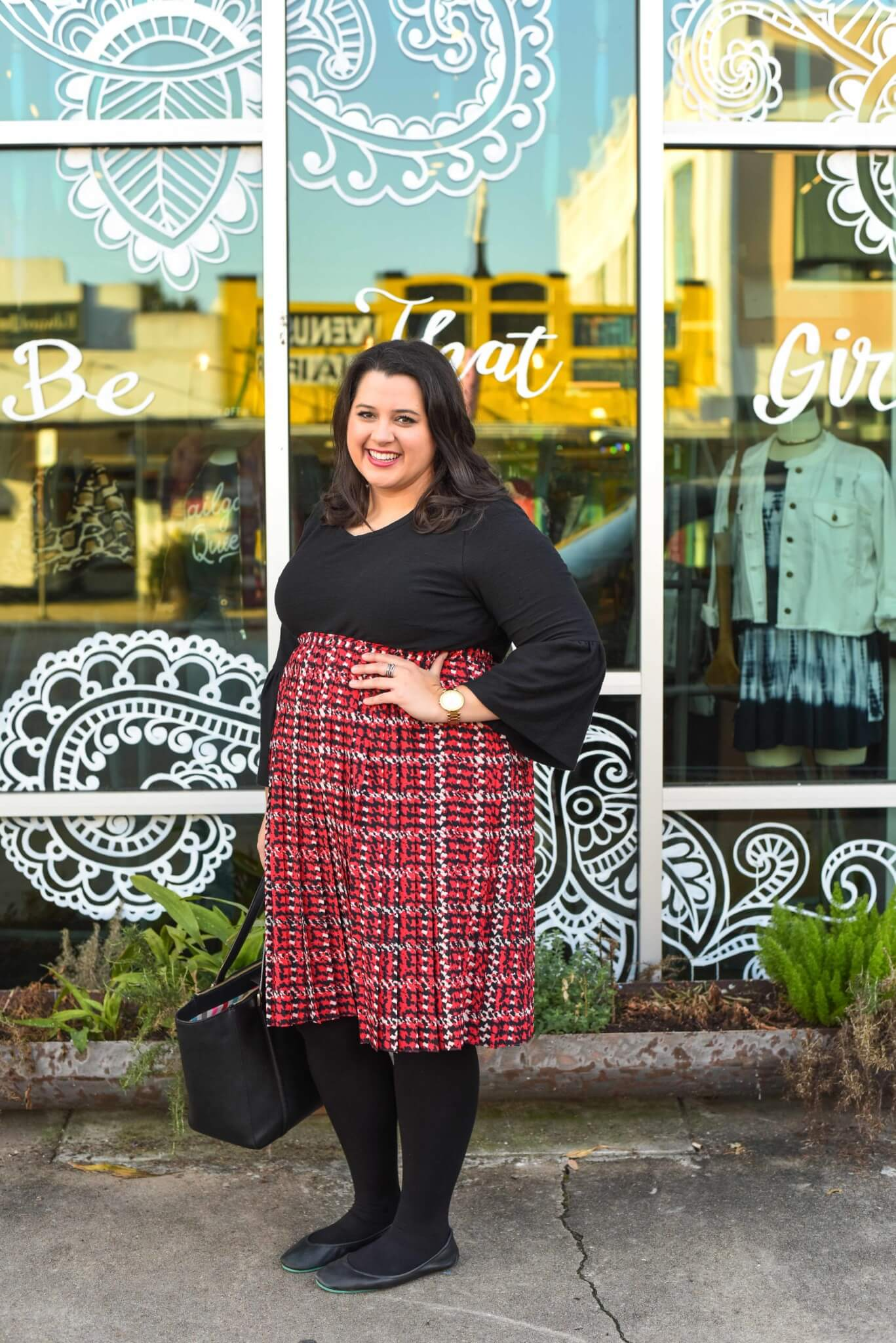 Dressing for all of the holiday season functions can be difficult epecially when you work long hours. Emily Bastedo from the curvy style blog Something Gold, Something Blue, is sharing her solution by styling a red plaid skirt and unique black sweater from Eloquii paired with gorgeous and comfortable Just My Size blackout tights and Tieks.