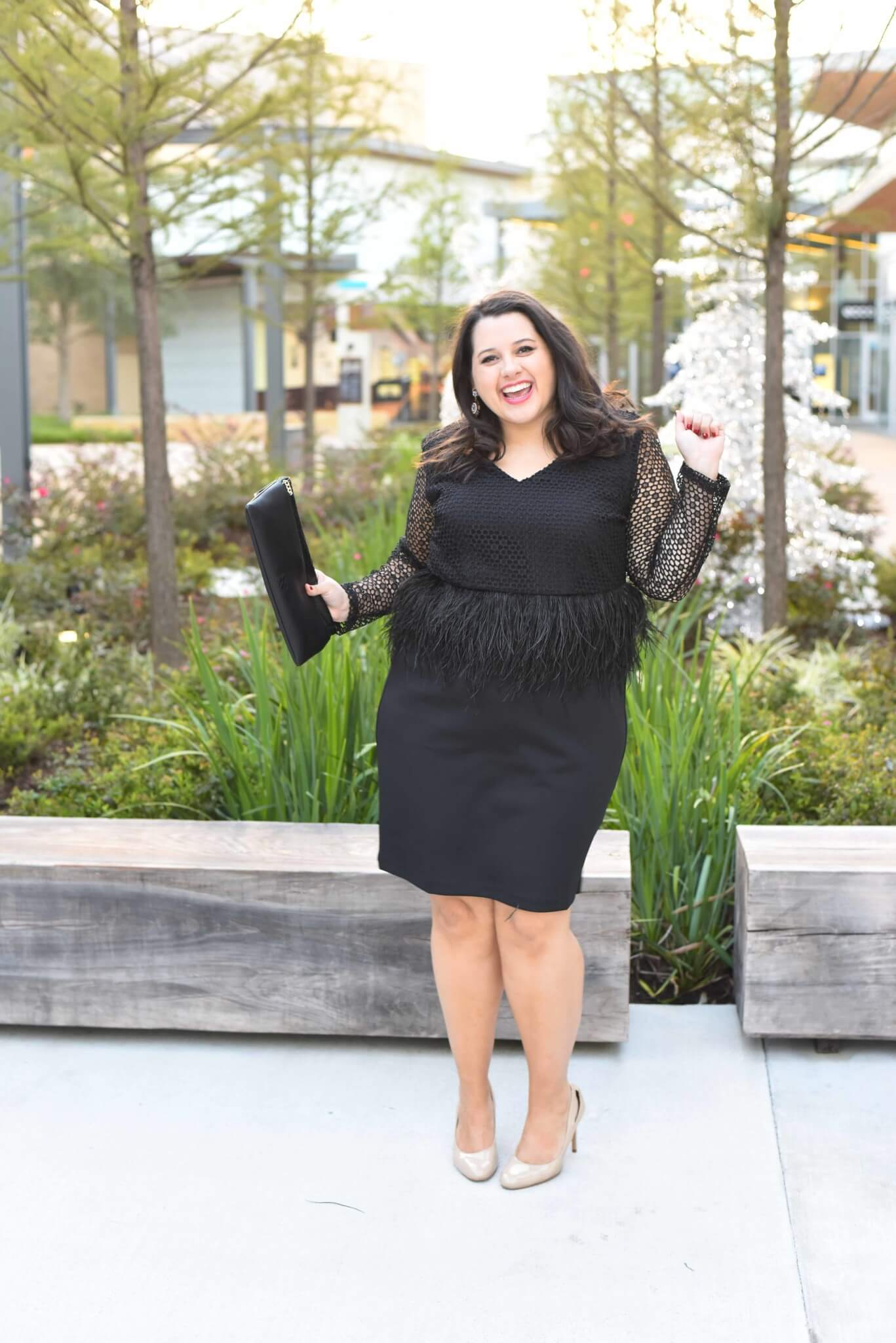 Emily from Something Gold, Something Blue is sharing her formal holiday party outfit including fabulous nude pumps, a gorgeous black lace and feather peplum dress and red crystal statement earrings. - @emilySGSB - About Emily, the woman behind popular Houston Curvy Fashion Blog, Something Gold, Something Blue
