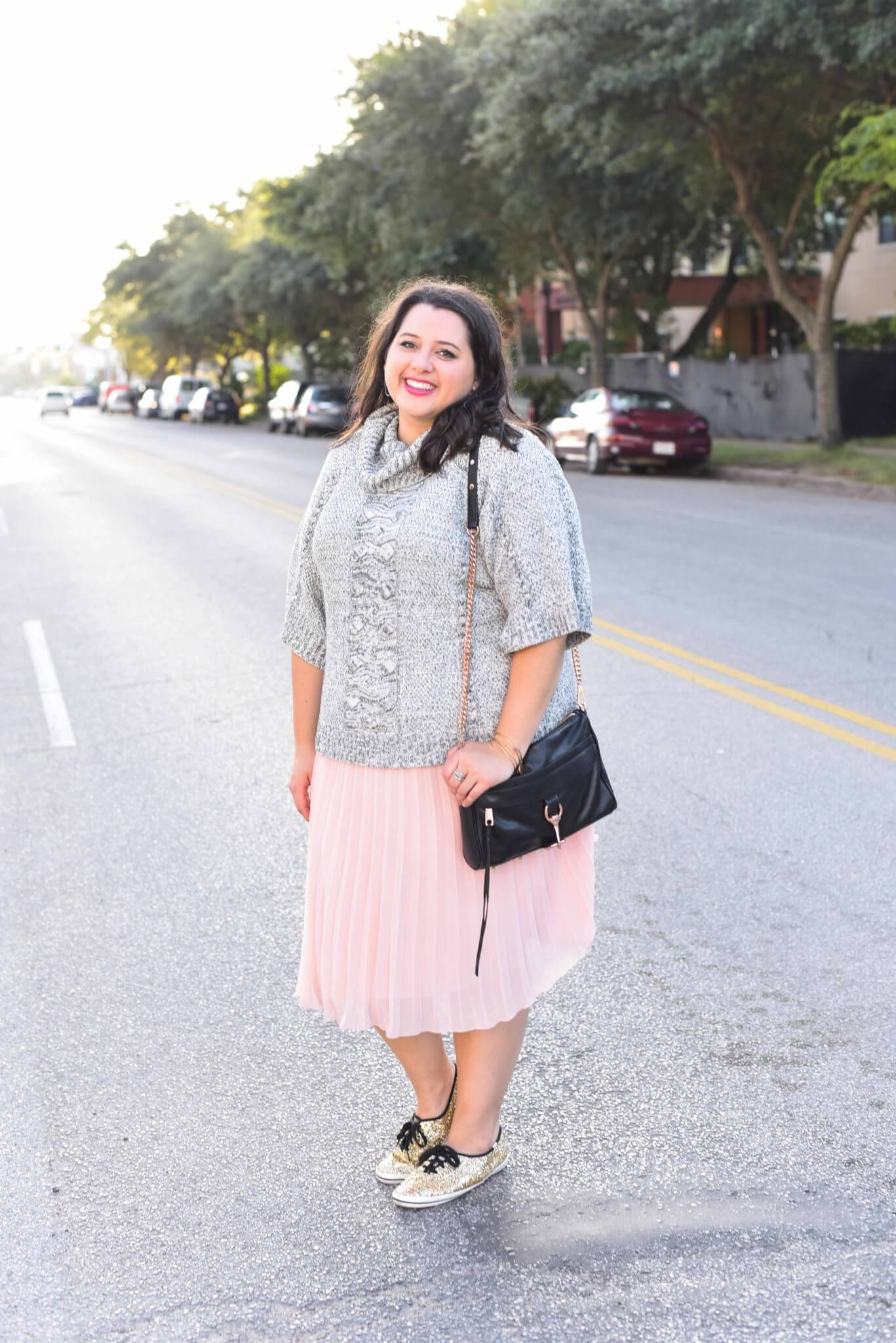 Being cozy this time of year is essential. Emily Bastedo from the curvy style blog, Something Gold, Something Blue is sharing her take on the perfect brunch outfit with a grey oversized turtleneck from Anthroplogie, a soft pink pleated skirt, giltter Kate Spade Keds and a few cute accessories.