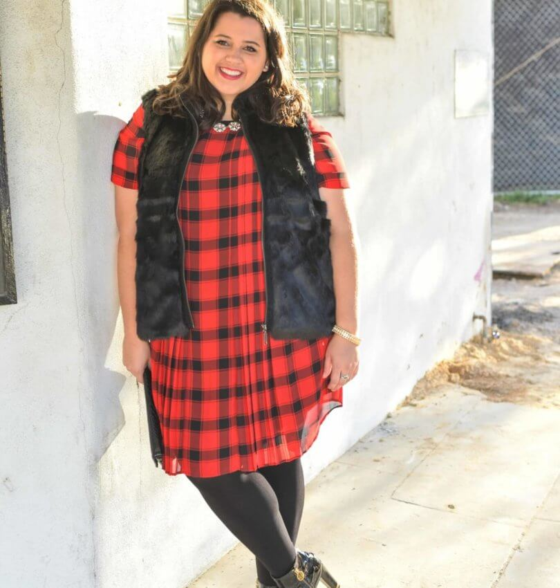The holidays can be stressful, but having a casual holiday party look planned out and ready to go is one way to help simplify your to do list. This red buffalo plaid shirt dress and black faux fur vest from Foxcroft make the perfect combination with some glamourous jewlery. - @EmilySGSB - Curvy Style Blogger from Something Gold, Something Blue