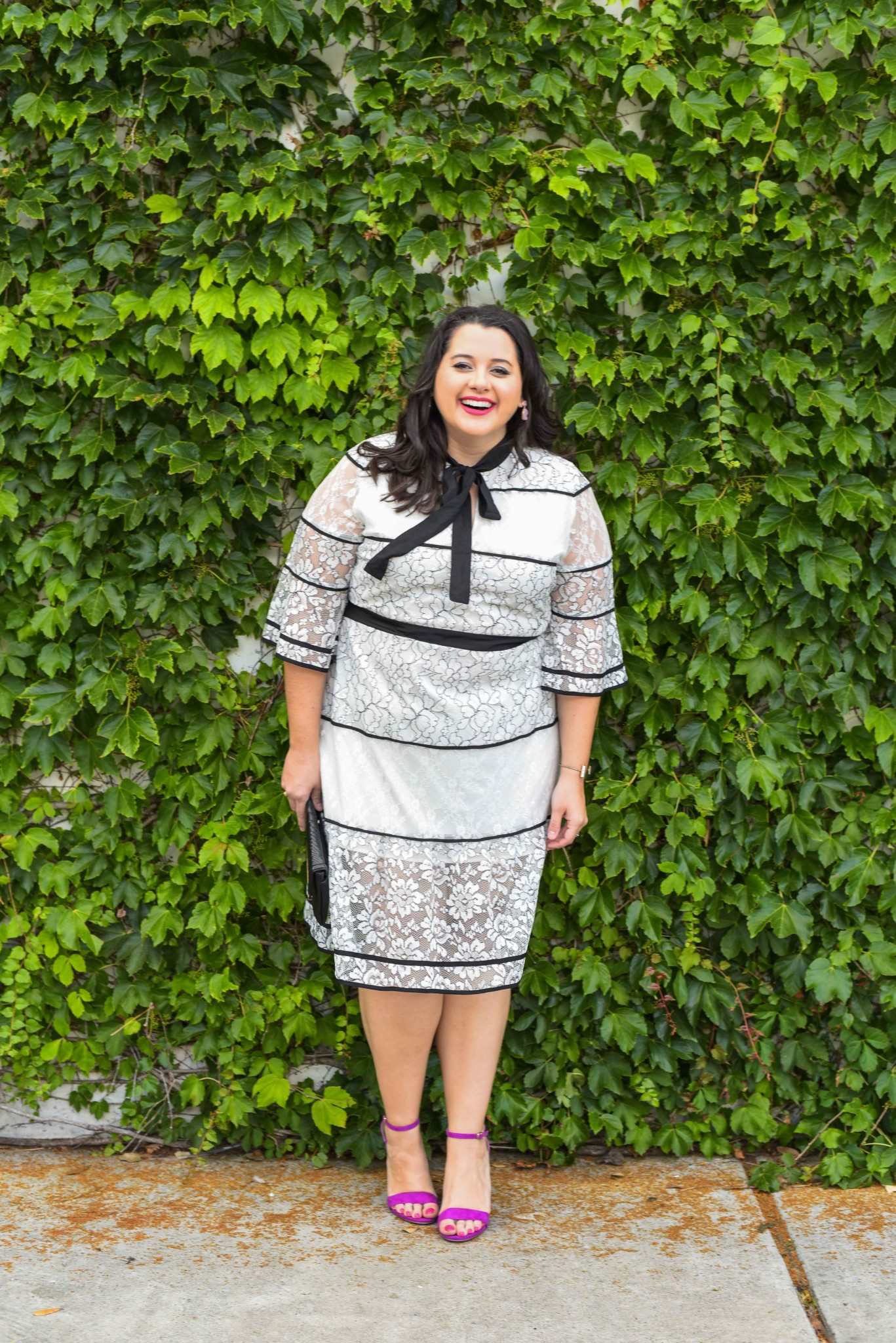 Finding a great white lace dress is essential for the summertime. This gorgeous fit and flare is from the plus size brand, Eloquii, which happens to be one of my favorite brands to shop from, which is why I'm sharing a few of my tips to save money when shopping at Eloquii and finding the best curvy fashion and plus size clothes at a steal.