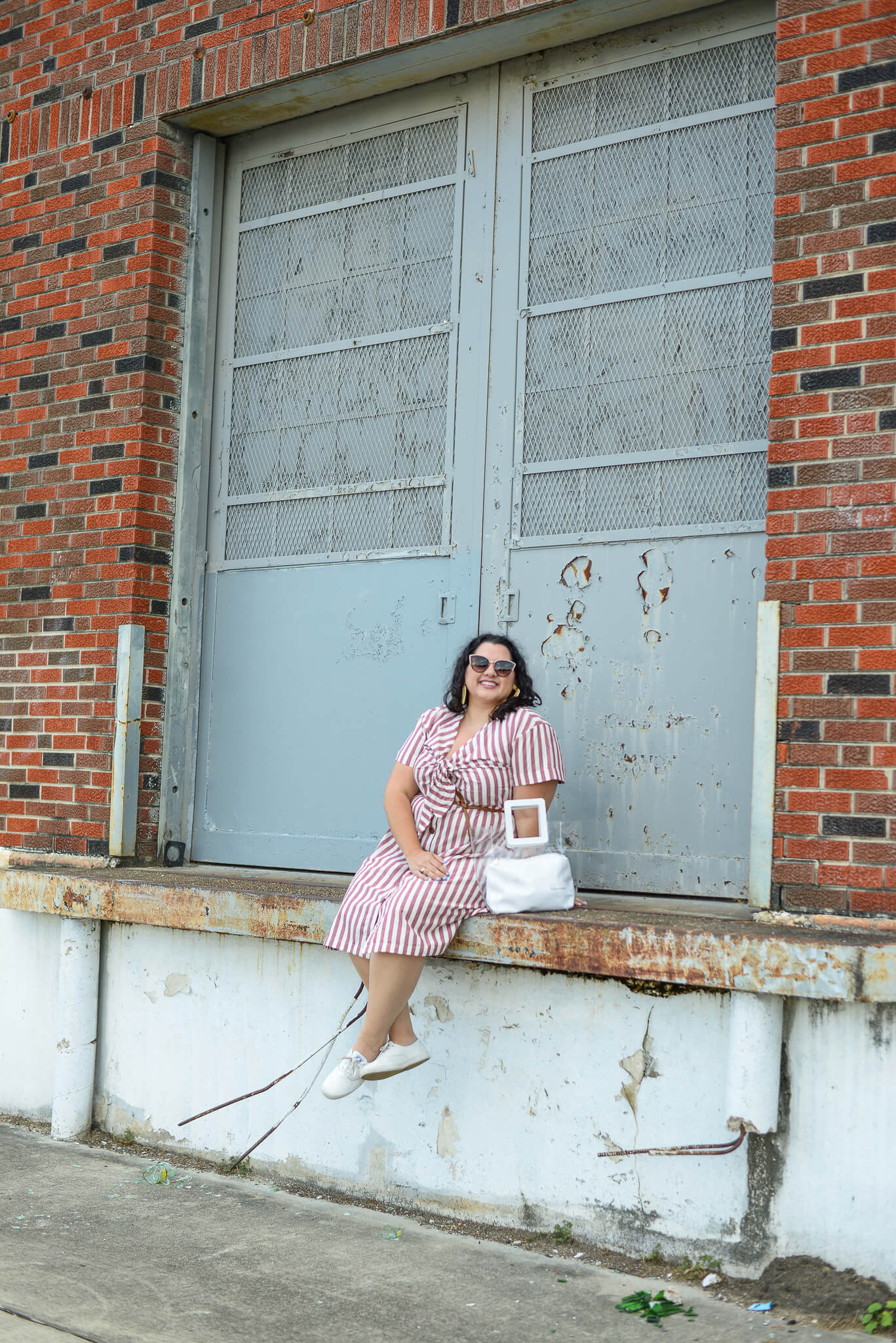 Avoiding the Texas summer heat by wearing this linen striped dress from Eloquii