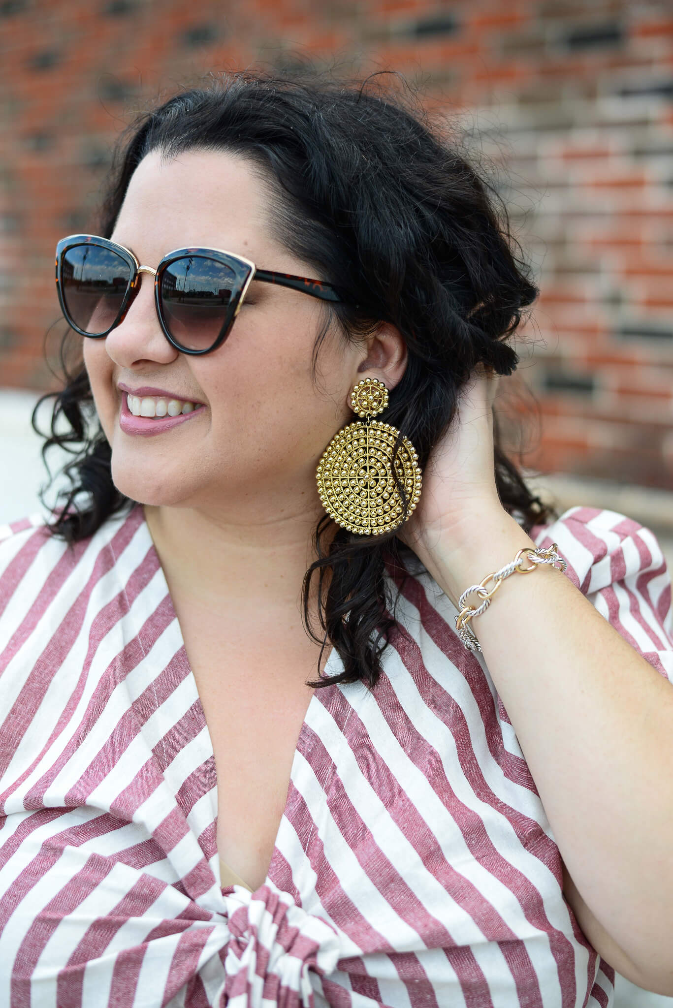 A statement earring easily adds a pop of fun without the added bulk