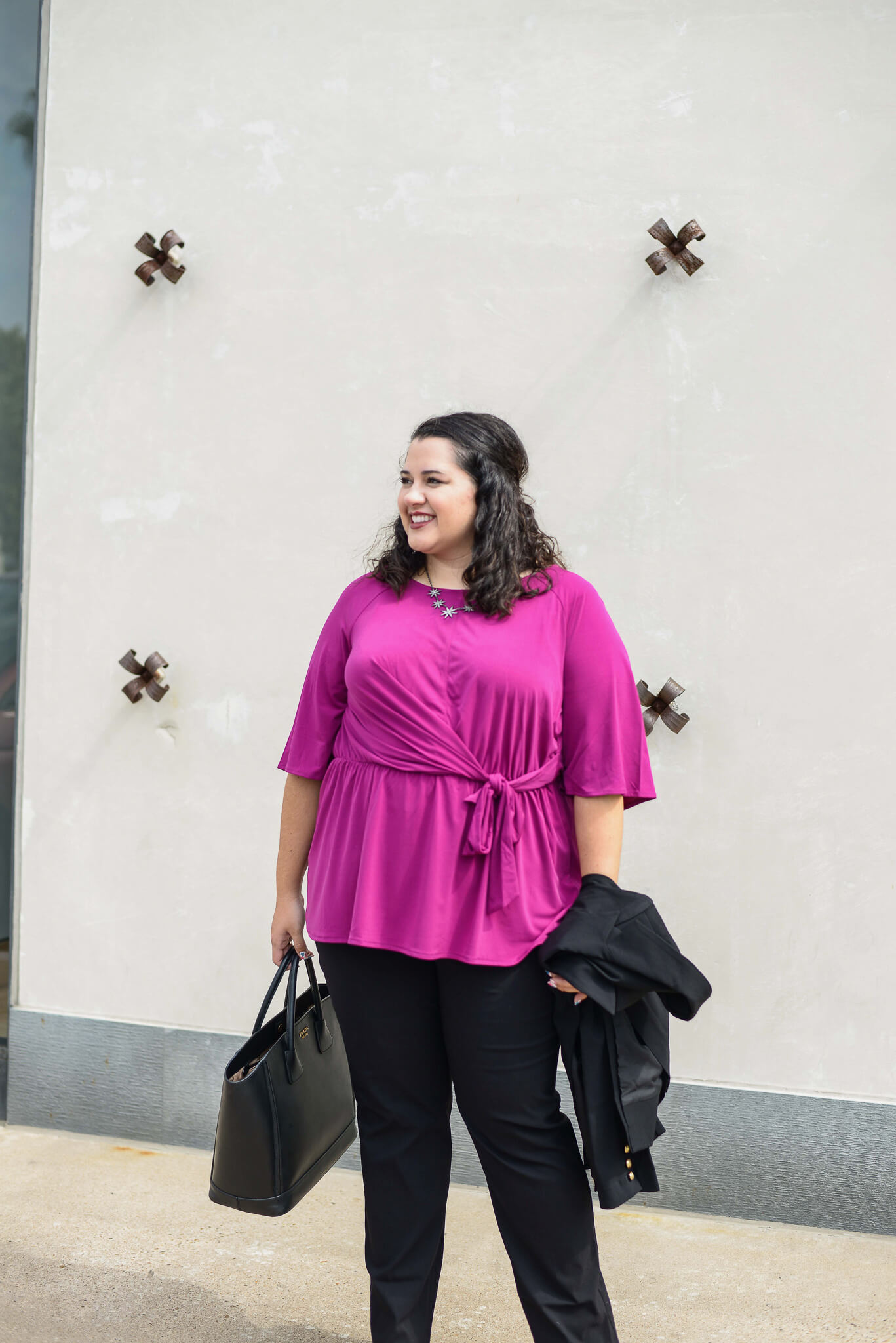 I love pairing a bright colored top with a neutral suit for the perfect plus size business casual outfit.
