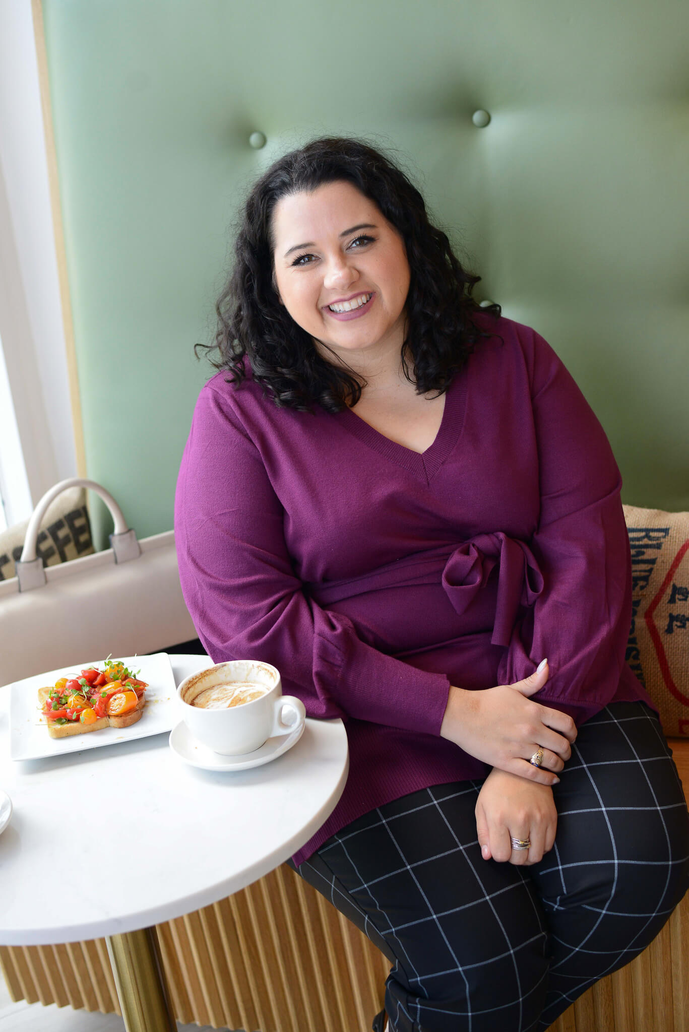 Working at a coffee shop helps to spark my creativity and get big tasks accomplished. By wearing the Eloquii Kady pants, I feel pulled together and ready to check my entire to do list off.