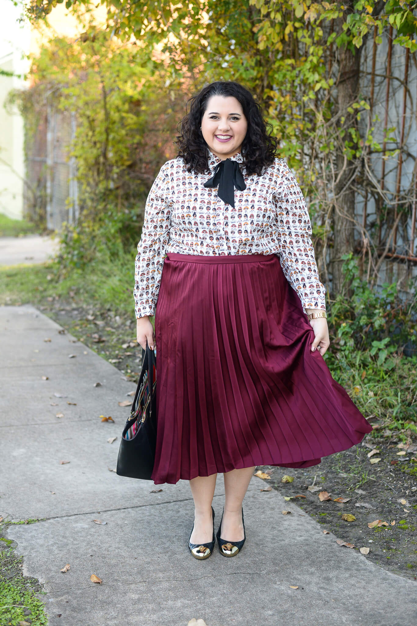 Finding a style at work can be difficult sometimes but a good colorful basic, like this pleated maroon skirt is a staple in every career woman's wardrobe.