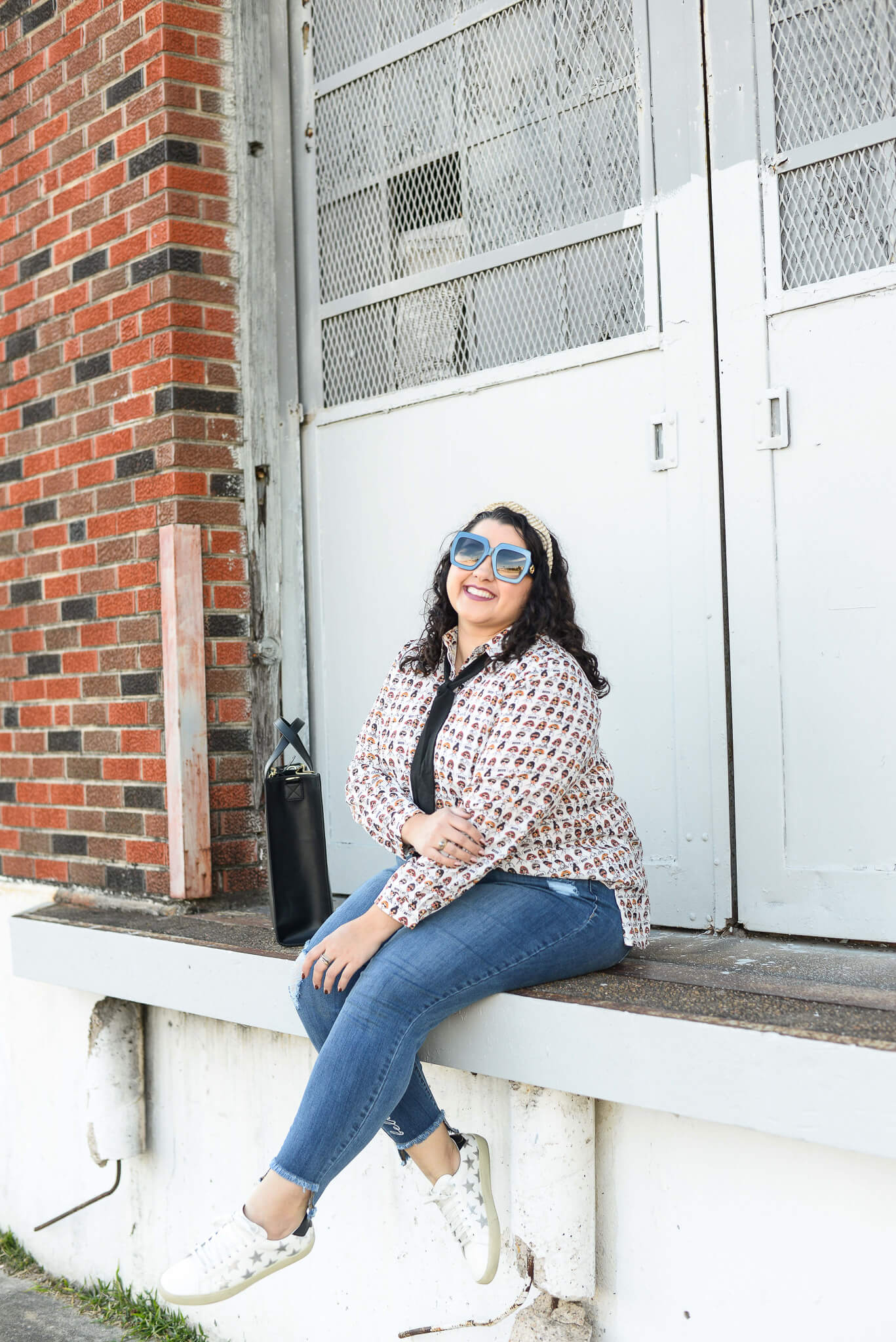 Jeans and bow tie blouse make for the perfect plus size weekend look