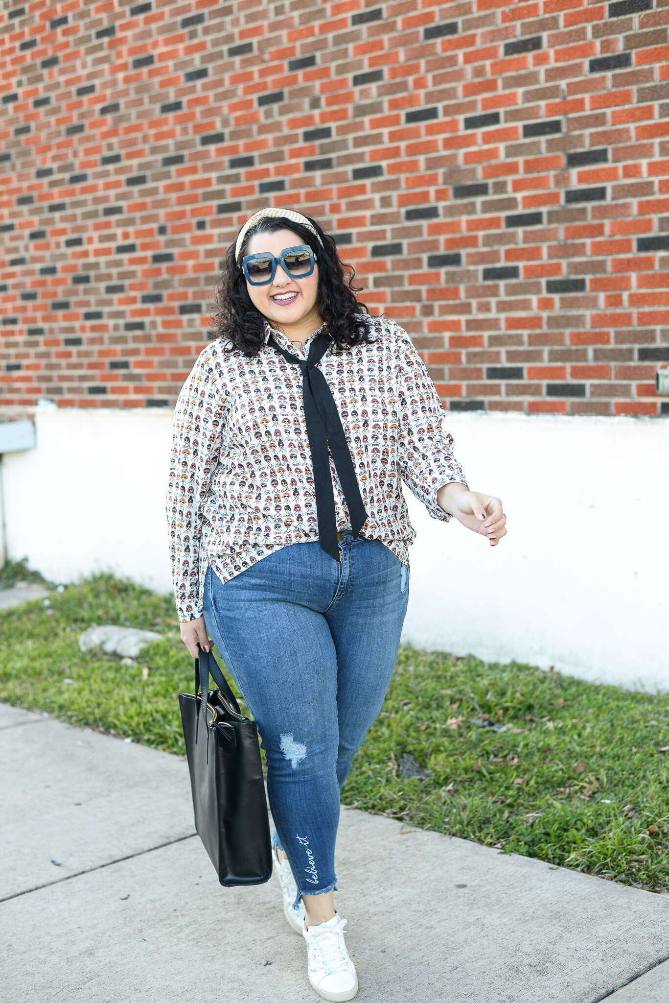 Running around town doesn't have to be boring when you have this plus size statement blouse in your closet!
