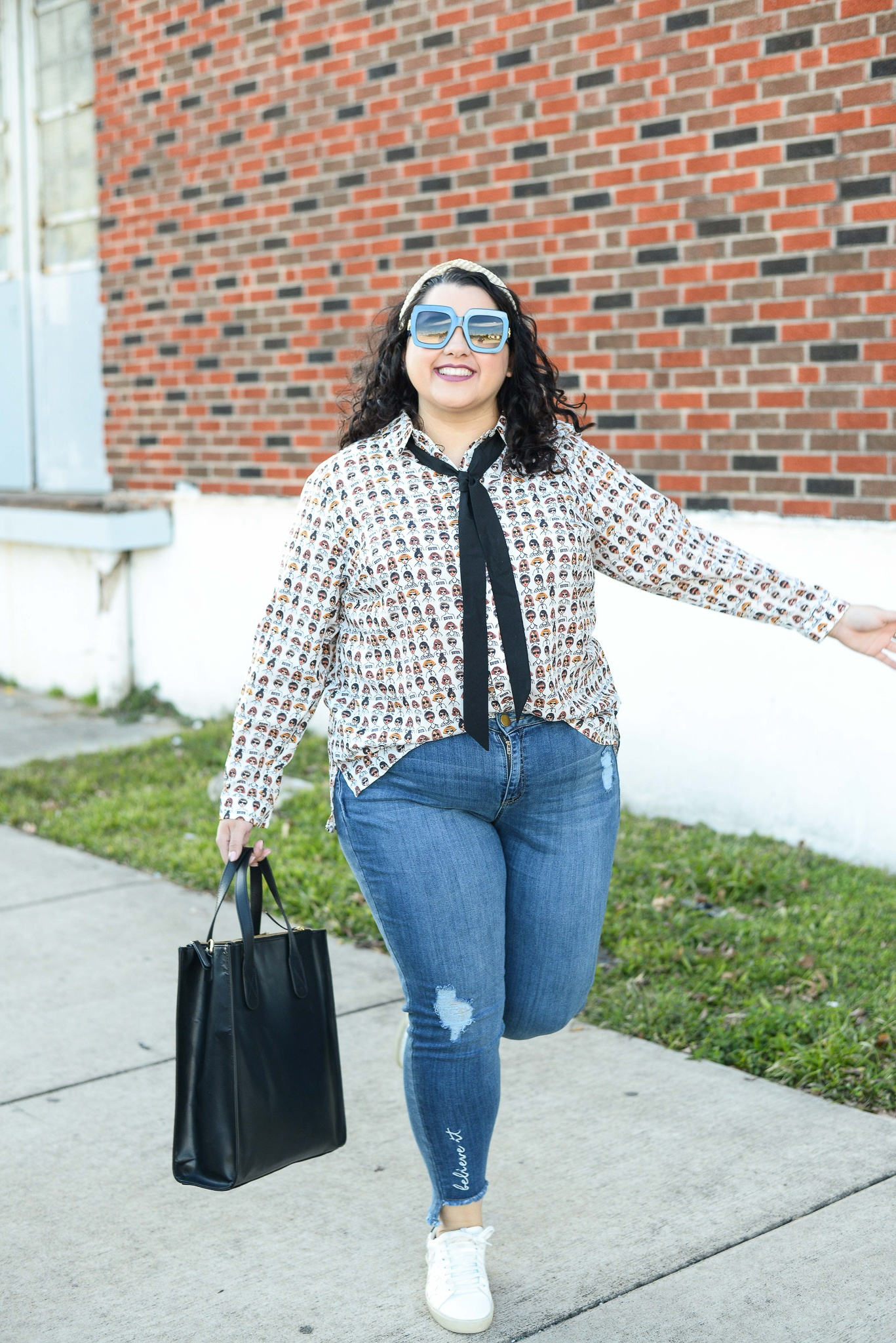 Jumping for joy because I was pushed outside of my style comfort zone when styling this plus size white blouse two different ways.