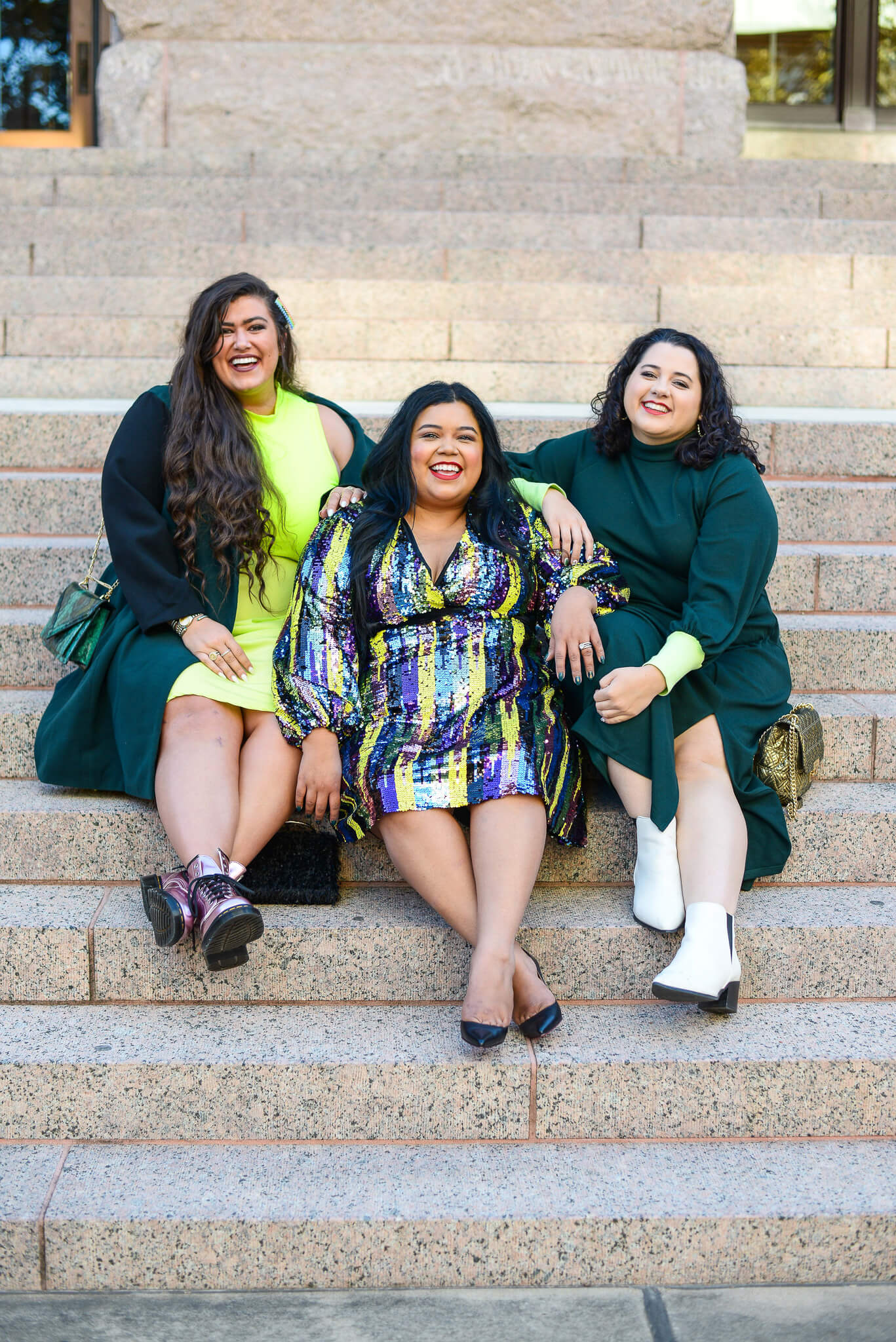 Plus size group of women wearing Eloquii emerald outfits