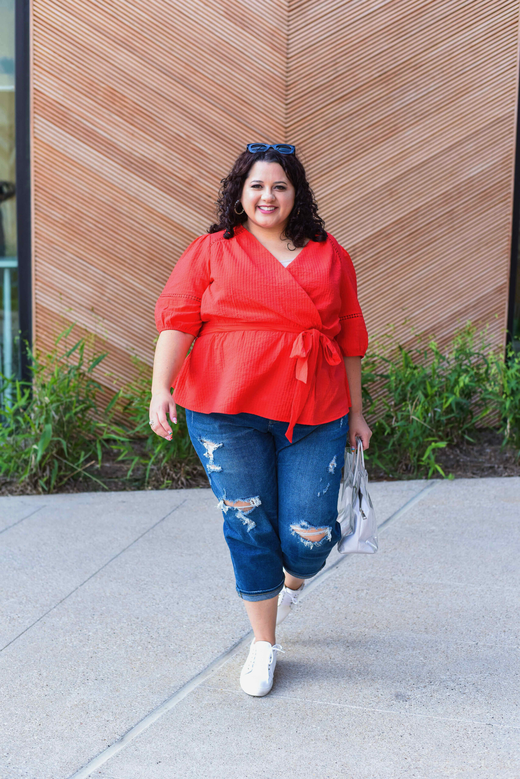 Red peplum tie top and casual blue jeans make for the perfect Memorial Day outfit.